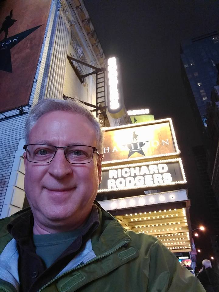 New York City tourist in front of the Richard Rodgers Theatre, waiting to go see Hamilton