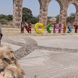 Me and Taco in front of the Nochistlán sign and the aqueduct
