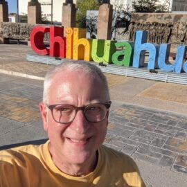 Lane standing in front of the letters spelling out CHIHUAHUA